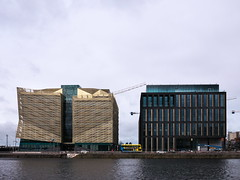 Central Bank and No. 1 Landings (turgidson) Tags: panasonic lumix dmc g7 panasoniclumixdmcg7 panasonicg7 micro four thirds microfourthirds m43 g lumixg mirrorless 20mm f17 asph panasonic20mmf17asph 20mmf17 20mmf17asph prime lens primelens pancake hh020 silkypix developer studio pro 7 silkypixdeveloperstudiopro7 raw p1210999 anglo irish bank angloirishbank hq headquarters new wapping street newwappingstreet unfinished abandoned brooks thomas brooksthomas liam carroll liamcarroll danninger north wall quay docklands dublin ireland central centralbank