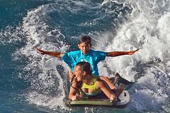 Boogieboarders (RicoLeffanta) Tags: bikini boogie board body mother son family boogieboarding ocean sport makaha buffalo keaulana big surfing classic oahu hawaii rico leffanta