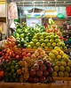 IMGP7844 Fruit at Ben Thanh Market (Claudio e Lucia Images around the world) Tags: market portrait lady smile smiling beautiful street hochiminh saigon vietnam pentax streetmarket vendor pentaxk3ii sigma sigma1020 fruit fruitmarket cibo