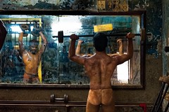 Kushti Wrestlers (silvia.alessi) Tags: kushti wrestling wrestlers athletes gym mumbai india incredibleindia portrait oldgym mirror reportage travel ngc body asia man skin athletic