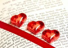 I Love Reading (Karen_Chappell) Tags: red white heart hearts ribbon book bookmark words paper stilllife three 3 letters read reading macro canonef100mmf28usmmacro
