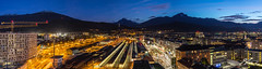 In The Evening, When We Are Sleeping (Tim van Zundert) Tags: innsbruck tyrol austria europe bluehour sky buildingsite construction crane railway trainline panorama panoramic landscape mountains city cityscape night evening longexposure sony a7r voigtlander 21mm ultron