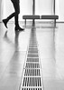 crossing the divide (jim_ATL) Tags: man stride step reflection floor vent museum art dof bw blackandwhite atlanta