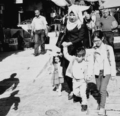 Noon time in Damascus Gate. (正午) (Monica@Boston) Tags: noon shadow market street outdoors monochrome blackandwhite family people israel jerusalem damascusgate
