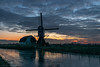 Windmill Along Frozen Canal (mesocyclone70) Tags: windmill mill canal water ice frozen sunset sky skyscape bluehour blue landscape holland netherlands reflections color colorful cloud clouds evening winter silhouette naturessilhouettes scenic scenery