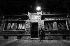 Stranger light (Daniel Nebreda Lucea) Tags: street calle city ciudad night noche noir old vieja antigua monochrome monocromatico man hombre people gente house casa light luz travel viajar relax window ventana door puerta atmosphere atmosfera atmospheric fear miedo shadows sombras canon 60d 1018mm urban urbano town pueblo zaragoza aragon spain españa europe europa black white blanco negro bw dark oscuro lights luces alley callejon