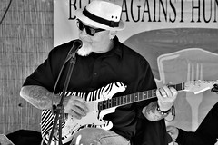 Blues gig (thomasgorman1) Tags: blues rock monochrome performance street streetshots streetphotos portrait mexico guitar smile smiling man candid stage sunglasses hat