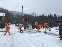 The gang clear snow off the level crossing 3Mar18