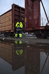 Ahead (ryanclark13) Tags: rain grey railroad train economy lumber timber steel wet winter water puddles
