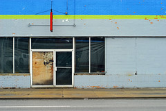 Indy#16917_Copy (Single-Tooth Productions) Tags: abandoned abandonedbuilding decay decaying storefront decayingstorefront doors windows glassdoors decayingdoor entry entryway entrance architecture architecturaldetail architecturaldecay architecturalcomposition composition colorcomposition shapes lines colorblocks 2d flat buildingstreetview neglect bleak brickfacade paintedbrick ewashingtonst indianapolis indiana urban city building buildingcomposition buildingdetail buildingdecay urbandecay 50mm nikkor nikkor50mm nikond200 nikon