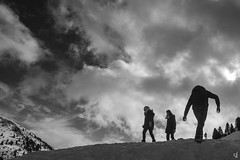 Trying to reach the top (tzevang.com) Tags: top greece bw snow landscape arkadia mount mainalo silhouette kids mountains canon5d clouds