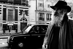 Maison Assouline (Neil. Moralee) Tags: londonneilmoralee man beard street hat moustache traffic taxi london piccadilly maison assouline scarf black white mono monochrome bw bandw blackandwhite portrait face old mature neil moralee nikon d7100 walk england britain british cab wealth wealthy rich