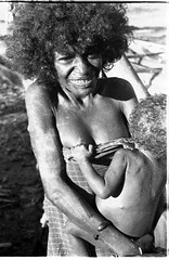 3mm negative by Oskar Speck depicting a woman wearing a sarong and holding a baby in her arms (Australian National Maritime Museum on The Commons) Tags: 1930s worldwarii germany australia travel newguinea market turtle sea hut beach canoe java papuanewguinea