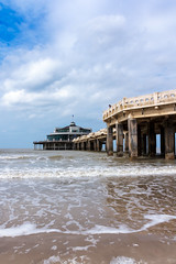Pier (Nils Croes) Tags: pier sea beach water pallisade sky clouds waves foam sand canon 60d 1740mm