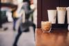 My coffee (ninasclicks) Tags: coffee latte glass cup mug cafe bokeh people girl silhouette street dof