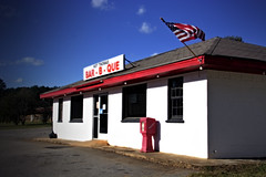 As American as... (Mike McCall) Tags: copyright2018mikemccall photography photo image georgia usa vernacular culture southern america thesouth unitedstates northamerica south historic oconeecounty oconee barbcue barbecue barbeque restaurant hotthomas business flag redwhiteblue signage