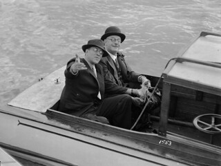 Two men seated in a motor launch on Sydney Harbour, c 1931