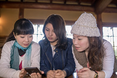 Female friends looking at screen on smart phone together (Apricot Cafe) Tags: img28770 asia asianandindianethnicities cafe japan japaneseethnicity kyotocity kyotoprefecture senioradult sigma35mmf14dghsmart casualclothing charming cheerful concentration day enjoyment freedom friendship groupofpeople happiness indoors lifestyles lookingatscreen midadult morning photography relaxation restaurant sitting smartphone smiling springtime sunlight surprise table teenager threepeople togetherness tourist traveldestinations waistup weekendactivities women youngadult kyōtoshi kyōtofu jp