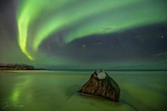 Going Green (Mr F1) Tags: borealis johnfanning goinggreen light rock skagsandenbeach water nightphotography stars cloud sky msand europe norway arctic cold ice snow streaks aurora northern lights