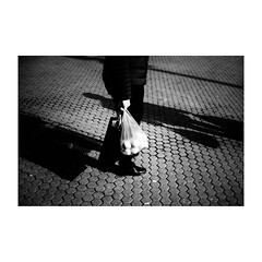 zagreb (s_inagaki) Tags: bw zagreb industar69 orange blackandwhite オールドレンズ plasticbag oldlens vintagelens ザグレブ bnw monochrome ビニール袋 street スナップ モノクロ 白黒 snap オレンジ walking