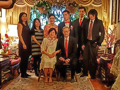 The Asian Tenenbaums (Whistler Whatever) Tags: tie suit reddress formal comedy couldbeamovie portrait parody photographer siblings father mother groom bride livingroom asian family chinese canadian