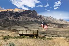 Flag Wagon (wyojones) Tags: wyoming cody wapitivalley wagon flag absaorkavolcanics moutains absarokamountains clouds wyojones np