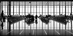 Stopover in Doha (jameslf) Tags: airport doha people qatar reflections black white