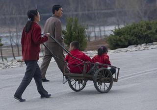 North Korean couple pushing a cart where are their children, Hyangsan county, Mount Myohyang, North Korea