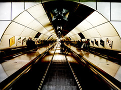 Two Down, But Only One Coming Up (Steve Taylor (Photography)) Tags: architecture art digital black brown white monocolor monocolour tile uk gb england greatbritain unitedkingdom london escalator tube tunnel underground