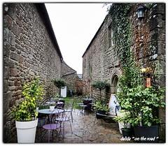 sous la pluie! (dalida '' on the road '') Tags: france bretagne terrasse village rue