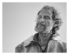 Paul (AEChown (away now)) Tags: hastings thestade fishermen fishermensmuseum monochrome mono environmentalportraiture environmentalportraits portraits documentary socialdocumentary portrait beard smoking curlyhair