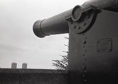 Woolwich dockyard (OhDark30) Tags: olympus 35rc 35 rc 35mm film monochrome bw blackandwhite bwfp fomapan 200 rodinal river thames path antique gun high calibre woolwich arsenal tower blocks