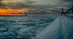 Sunset on ice #8 (tquist24) Tags: hdr lakemichigan michigan nikon nikond5300 stjoseph stjosephlighthouse clouds cold evening frozen geotagged ice lake pier sky snow sunset water winter saintjoseph unitedstates