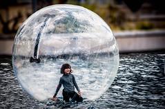 The little girl in the bubble (Dan Guimberteau) Tags: charente france poitoucharentes enfant futuroscope poitou poitiers fr child fun nikon d90