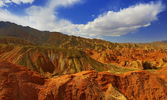 The Silk Road : Zhangye Danxia Landform in autumn . . . 張掖丹霞 絲綢之路 (Clement Tang **busy**) Tags: travel concordians closetonature china autumn afternoon landscape scenicsnotjustlandscapes whiteclouds bluesky hdr cplfilter sidelit nature nationalgeographic geologicalfeature erosion unesco thesilkroad 張掖丹霞 zhangyesdanxia zhangyedanxialandform theeyecandyofzhangye 甘肅張掖國家地質公園 絲綢之路 gansuzhangyenationalgeologicalpark