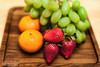 Painted Fruit Platter on a Wooden plate.jpg (mraderstorf) Tags: wood nikond700 grain plate orange red seeds grapes 36534 harvest vegitarian strawberry nikon50mmf14 healthy 365365project green fresh fruit picked project365 food