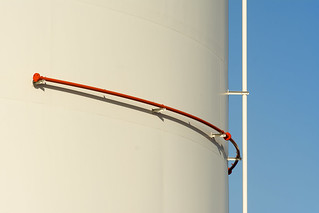 Storage tank with red pipe