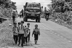 -c20170519-810_3881 (Erik Christensen242) Tags: vietnam daknong students children boys bw monochrome street truck traffic