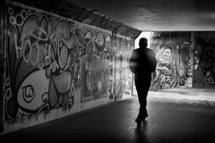 the shadow man (Daz Smith) Tags: dazsmith fujixt20 fuji xt20 andwhite bath city streetphotography people candid citylife thecity urban streets uk monochrome blancoynegro blackandwhite mono graffiti mural underpass tunnel silhouette man walking light rays