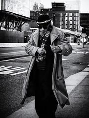 The Fastest Draw (Feldore) Tags: newyork man trench coat sunglasses scarf sinister street candid draw shades manhattan feldore mchugh em1 olympus 17mm 18 pulling pocket western cowboy