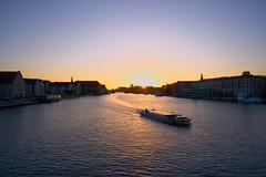 Copenhagen sunset (Geoff Fagan) Tags: copenhagen sun sunset sunlight water reflection starburst denmark sony sonyalpha