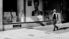 Candid - Place St-Laurent (Phonatics) Tags: candid urban streetphotographer streetphotography black white bnw bw light shadows people lausanne switzerland nikon d300 nikkor 50mm