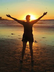 Praise the sun (jazzmoon12) Tags: woman beach sunset happy sun silhouette wife joy rejoice enthusiastic jubilant wow good day carpediem california female fit arms open zen legs life people human present twilight light photography worship goddess nature shorts delight sing hands glory