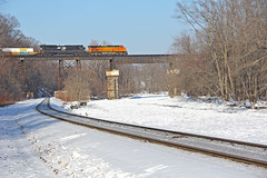 NS 22K (craigsanders429) Tags: conneautohio conneautcreek norfolksoutherntrains nsinconneautohio trestles bridges railroadbridges snow snowandice intermodaltrains nsintermodaltrains bnsflocomotives bnsfmotivepower rivers riversinwinter winter winterphotography winterrailroadphotography winterontherailroad