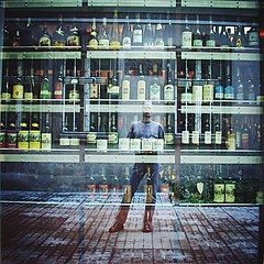 A difficult choice (Yacenty) Tags: drinking alcohol wine men shop showcase 200208 bottle window mirror glass difficult choice