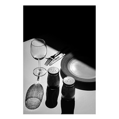 Dinner (Blackcat71) Tags: dinner plates fork salt pepper knife cutlery glass shadows dark sunlight window light bw black white mono fujifilm xt1