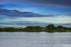 Nostalshoot...!! (Nita_Fotos) Tags: clouds •blue •orange •sol •atardecer •nubes •naranja •cielo •mountain •montañas •reflection •reflejos •trees •arboles •agua •backligh •contraluz lecheria venezuela tuniñasalvajedelaselva