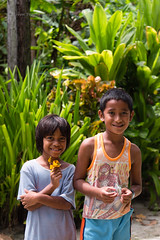 Making friends (- drsteve -) Tags: yap children origami flower frog helicopter silver jungle siblings dualiso cute micronesia fsm green portrait kids smile