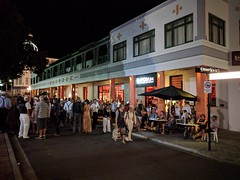 Art Deco by Night (Kevin Fenaughty) Tags: people outdoor building hotel masonic artdeco street umbrella night napier newzealand