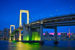 Rainbow Bridge & Blue Hour (Luís Henrique Boucault) Tags: architecture asia asian bay blue bridge building business city cityscape color colorful district downtown dusk evening famous financial horizontal illumination iron japan japanese kanto landmark metallic metropolis modern night office outdoor panorama panoramic place rainbow reflection river road scene scenic sea skyline street suspension tokyo tower travel twilight urban view